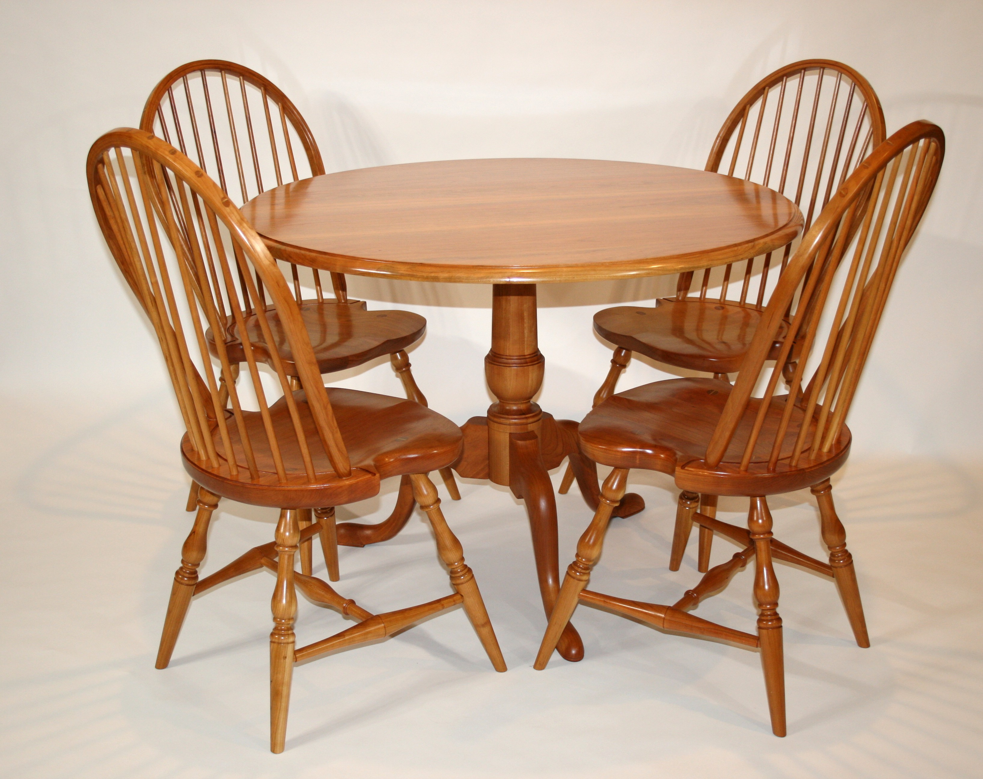 lighthouse woodworking solid cherry dining table with four solid cherry windsor side chairs for a client in winchester virginia finish is danish oil and polyurethane